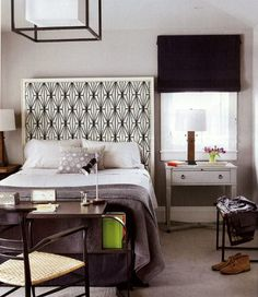 square headboard with a white frame, upholstered in black and white fabric