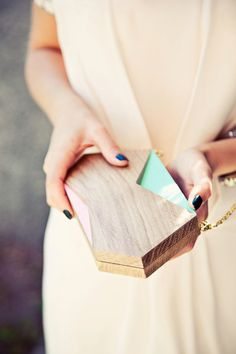 A beautiful geometrical minimalist wood clutch, just perfect for going out or attending a wedding. Its shape brings the basic clutch to the next level of cool and sophistication. Made of a oak wood, turquoise and light coral paint. Has a metal gold color shoulder handle and magnets lock to be sure that nothing fall out when you dance :) A perfect gift for someone unconventional who has industrial and minimalistic perspective.  Product information 20 x 10 x 4cm   Material: Oak wood   I was…