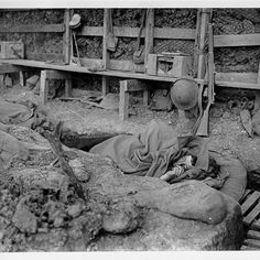 Australian soldiers asleep in a first line trench