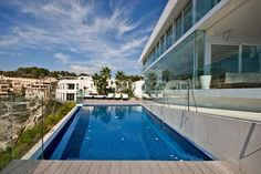 Waterfront Villa with glazing Scenery to spoil your Mind: Poolside Next To The Terrace Of Modern And Luxury Villa With Glazed Fresh Blue Mediterranean Sea View In Site Of Nautical Club Of Santa Posa