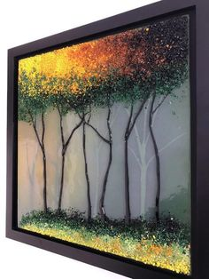 Bring nature inside with this amazing handmade fused glass panel. This beautiful piece of art is measures 13 inches x 13 inches framed. It took almost 80hours of kiln time to make. Each layer is made strictly using only glass the final layer adds the most depth with textured glass on top.