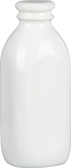 """Nostalgic porcelain bottle in a classic milk-bottle shape gives new life to the term """"milk glass."""" Store-and-serve bottle is fitted with a silicone lid."""