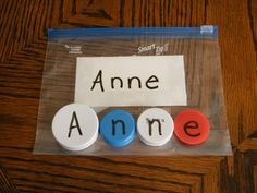 Write childs name on a index card, and a letter on each bottle cap.  Fun way to teach kids to write there name