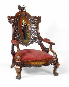 """1851 British Armchair at the Victoria and Albert Museum, London - From the curators' comments: """"This large easy chair was designed to contrast with the light, feminine chair. The conventional form, with a low, wide seat and padded arms, is typical of chairs intended for masculine use in the 1840s and 1850s....The porcelain plaque depicting the Prince Consort on the back of this chair is a reminder of his important role in the planning of the Great Exhibition of 1851."""""""