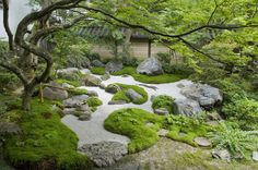 and mounds created around a stone swale in a japanese garden. Islands and mounds created around a stone swale in a japanese garden.Islands and mounds created around a stone swale in a japanese garden.