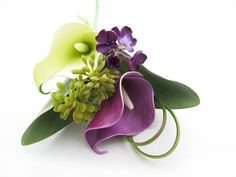 Vibrant combo of green and purple calla lilies, bear grass loops, tulip leaves, seedheads and purple lilac florets.