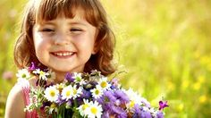 Google Image Result for http://ak0.picdn.net/shutterstock/videos/1235329/preview/stock-footage-little-girl-with-flowers-laughing.jpg