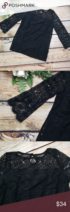 """Max Studio Black Lace Overlay Top Max Studio   Black 3/ Sleeve Blouse / top. Splayed sleeves. Gorgeous lace over black fabric. No liner on shoulder,  arms or upper back area. Keyhole back with single button closure. Shell, 100% Nylon, lining Poly/ Rayon. Sz Medium.   Approximate measurements laying flat: Chest:17.5"""" Length:26.5"""" Arm:19""""  SMOKE FREE HOME Max Studio Tops"""