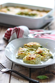 Spinach & Artichoke Ravioli Bake  An easy, cheesy rich and creamy spinach and artichoke ravioli bake. Easy to make with convenience items from grocery stores!