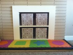 Turn an unused fireplace into storage.  Simply cap the gas line, build a box with a shelf that is large enough to insert into the fireplace, add trim to secure it into place. Add decorative boxes to hide items such as toys or use as a bookshelf.  When you want the fireplace back simply remove the box.