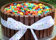 Kit kat and m & m's cake I so want to try this for my birthday! I made this for my moms birthday last year and it was so easy and looked great it was around Easter so I had a chocolate bunny sucker in the middle  which made it look great!