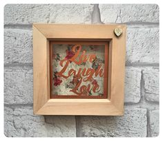 A personal favourite from my Etsy shop https://www.etsy.com/uk/listing/287466651/live-laugh-love-miniature-framed
