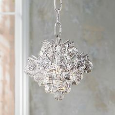 The crystal body of this contemporary mini chandelier offers your home a perfectly-sized modern update.