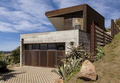 Raw corten steel and concrete exterior dress the Crossing Wall House, sited where the Santa Ynez Mountains meet the Pacific Ocean - CAANdesign Best Interior Design Websites, Interior Design Boards, Beautiful Interior Design, Concrete Siding, Huntington Homes, Mobile Office, Corten Steel, Wall Crosses, Prefab Homes