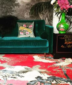 Jungle Decor: Exotic Maximalism For Your Home - jungle decor red Asian rug green velvet sofa Green Velvet Sofa, Green Sofa, Vintage Porch, Asian Rugs, Asian Home Decor, Eclectic Decor, Modern Decor, My Living Room, Living Spaces