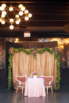 501 Union lesbian wedding. Photos by Mikkel Paige Photography, in Brooklyn, NYC. Planning by Ashley M Chamblin Events. Overall room photo with pink linens and brightly colored flower centerpieces. Gold sequin backdrop.