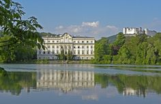 View of Schloss Leopoldskron and the Salzburg fortress from across the lake