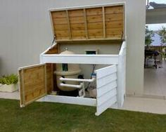 Summer style!! Excellent idea for wood box with hinged lid and doors for pool equipment! Maybe add hooks on house to hold up lid? Paint white to match house!