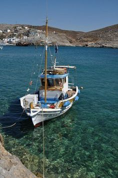 Picture of beautiful fishing boat at the bay of Pserimos island, Greece stock photo, images and stock photography. Travel List, Greek Islands, Planet Earth, Fishing Boats, Sailing, Greece, Stock Photos, Vacation, Canisters
