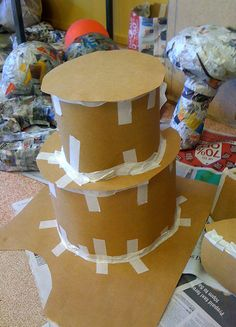 Google Image Result for http://www.adelle.com.au/wp-content/uploads/2010/08/papier-mache-wedding-cake.jpg