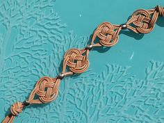 """To commemorate St Patrick's day, here's a project that incorporates an important Irish symbol – the Celtic Knot. This bracelet is macramé, and uses one of the most popular types of """"Ce…"""