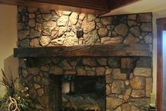 A stone fireplace evokes a rustic and natural feeling that is enhanced by rustic fireplace mantels. A hand-carved beam complements the style of a stone fireplace. Traditional woodworking tools and a reclaimed wood beam are all that is required Fireplace Mantels For Sale, Farmhouse Fireplace Mantels, Rustic Fireplace Mantels, Wooden Mantel, Farmhouse Decor, Fireplace Ideas, Mantles, Mantels Decor, Cabin Fireplace