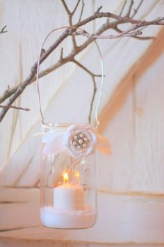 How to wrap a wire around a mason jar...tie a ribbon with flower...fill with salt and add a candle!
