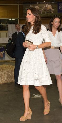 Kate and William visited the Sydney Royal Easter Show on April 18. Kate was dressed in a white eyelet Zimmermann dress, carried her LK Bennett 'Natalie' clutch. via StyleList