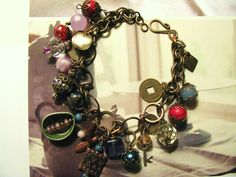 vintage inspired charm bracelets made from upcycled beads and findings combined with new components...