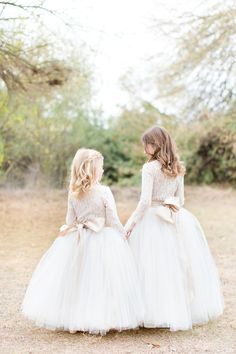 Super cute and sophisticated flower girl outfits with full tulle skirts, lace leotard tops and champagne bows. Neutral, ivory, cream and white. Flower girl dress dreams!