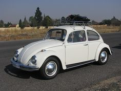 My first car was a 1972 volkswagon super beetle that was white and had blue interior . Mine was brush painted and you could see the brush strokes in the paint.