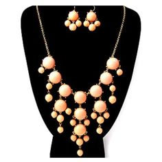 "Peach and gold bubble necklace and earring set Peach bubble necklace and earring set Gorgeous necklace and earring set! Dress it up or make it casual! Perfect for any occasion! Marked ""Not For Sale""? Check with me! I get jewelry in stock periodically and can let you know if it's back! Jewelry Necklaces"