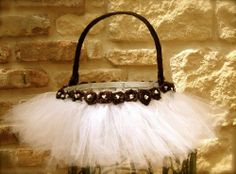 These tulle-skirts are really popular on Easter baskets.  25 Cute and Creative Homemade Easter Basket Ideas
