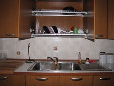 I HATE washing dishes.  Here are a bunch of hacks that make a lot of sense, especially turning the cabinet above your sink into a drying closet (above).
