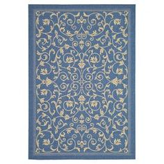 """Anchor your patio seating group or define space in the den with this artfully loomed indoor/outdoor rug, featuring a scrolling motif for eye-catching appeal.  Product: RugConstruction Material: 0: Blue and naturalFeatures:  Power-loomedMachine madeSuitable for indoor or outdoor use Pile Height: 0.25""""Dimensions: 9'2"""" x 12'6""""Note: Please be aware that actual colors may vary from those shown on your screen. Accent rugs may also not show the entire pattern that the ..."""