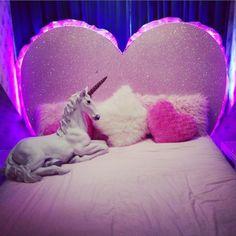neon backlit heart headboard + fluffy cushions