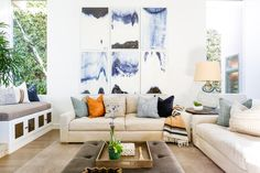 Project San Clemente | Part Three - Blackband Design  Gallery Wall over living room sofas. Symmetrical design