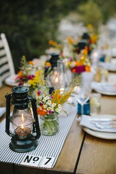 Summer Lovin' - Sleep Away Camp Wedding Inspiration , the table settings - Dress up bench style picnic tables with vintage lanterns and bunches of wildflowers. Serve your drinks in mason jars and scatter Campground Wedding, Camp Wedding, Wedding Table, Wedding Reception, Wedding Day, Camping Wedding Theme, Wedding Rustic, Wedding Notes, Wedding Dreams
