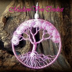 This tree of life pendant features pink colored copper wire and a unique spiral design. I painstakingly added the handcrafted spirals one at a