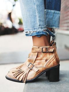 free people - Circle Back Heel Boot | Distressed leather ankle boot featuring a pointed toe with fringed tassel detailing.  Buckle accents with an adjustable ankle strap and a back zip for an easy on/off.  Stacked heel.