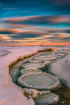 Ice circles were formed along the edge of the lake in Port, Union few days after the snow storm, Scarborough, Ontario ~ By Marvin Evasco