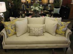 yellow loveseat | My favorite thing to do with pillows, is pile them on a large sofa ...