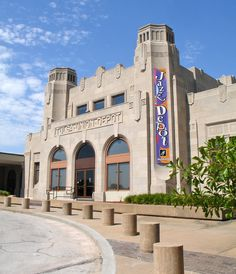 Tulsa Union Depot designed by R. C. Stephens, was completed in 1931. Art Deco Architecture reveals the inspiration of machinery as a theme for geometric designs. The desire for machine-like geometric clarity evident in this building became something of a mania in the 1930s. The Depot serviced as many as thirty-six trains a day in its prime. However, rail travel diminished as the years rolled by and need for the Depot's services decreased. It ceased operation in 1967.