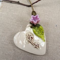 Maybe I can do this in glass - Rustic ceramic heart with pink art glass flower, an awesome Valentine!