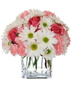 Interested in surprising someone special? The Sweetest Surprise Bouquet from Avas Flowers is sure to brighten the day. Pink spray roses, pink mini carnations and white daisy poms are arranged deliciously in a clear vase adorned with pink ribbon.