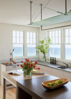 i love how bright and open the kitchen is and the view from the windows
