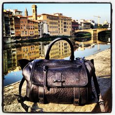 Spotted #Rafe #Heather satchel enjoying the view of the Arno in Florence. Get this fab bag at @zappos_couture