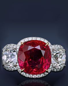 Jacob&Co 10.20 Ct. Cushion Cut Pink Red Ruby, Flanked By 2 Cushion Cut Diamonds Framed By 4.40 Ct. Pave' Set White Diamonds