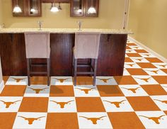 """Texas Longhorns carpet tiles with vinyl backing. The carpet top is 0.04 inches and the overall tile has a thickness of about 1/4 inch. Ideal for gyms, exercise rooms, game rooms, kids' play areas.  Each box includes 10 logo tiles and 10 solid tiles in Longhorns colors.  Each tile measures 18"""" x 18"""" with a coverage of 45 square feet per box.Tiles can be cut with a straight edge and a pair of scissors or a utility knife. No padding or underlay required. Easy installation.  Great for the DIY…"""