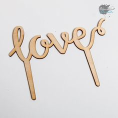 Laser cut cake topper for a wedding.  Blacklist can customise cake toppers for your special day. #LaserCut #Love #Wood #Cake #CakeTopper #Wedding #WeddingCake #RusticWedding by blacklistprints